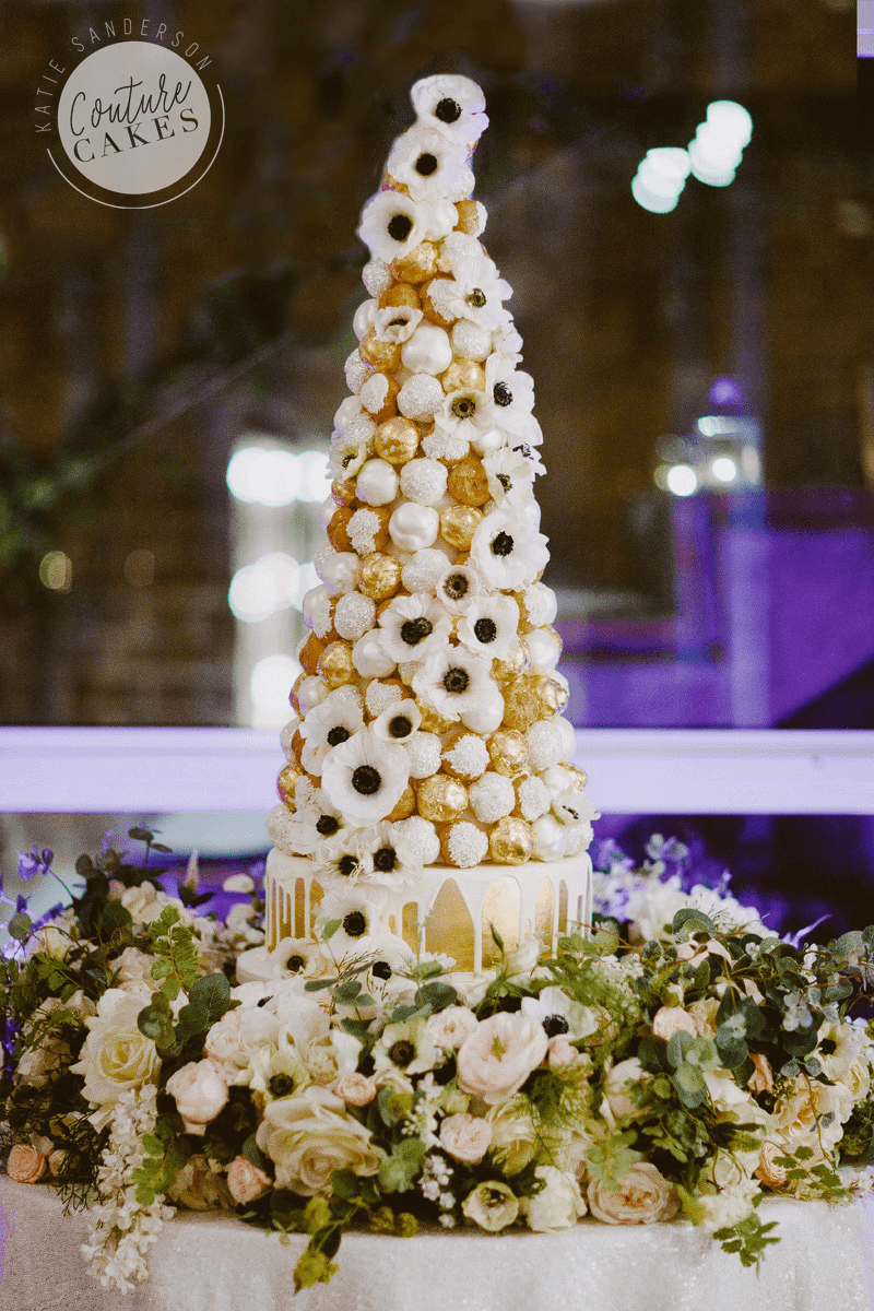 Croquembouche serves 200 profiteroles £395, plus cake serves 75 portions £195, optional gold leaf £50 gold. Flowers provided by brides florist.