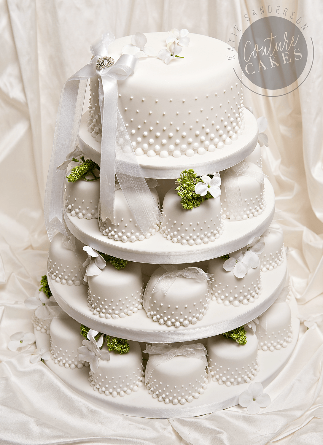 Serves 46 mini cakes & 20 portion top tier, Price as pictured £577 (with 46 mini cakes & 20 portion top tier)