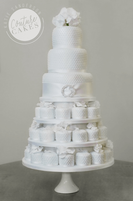 Tiered Cake serves 70 portions, Price £475, plus £323 for 36 mini cakes & tiered stand