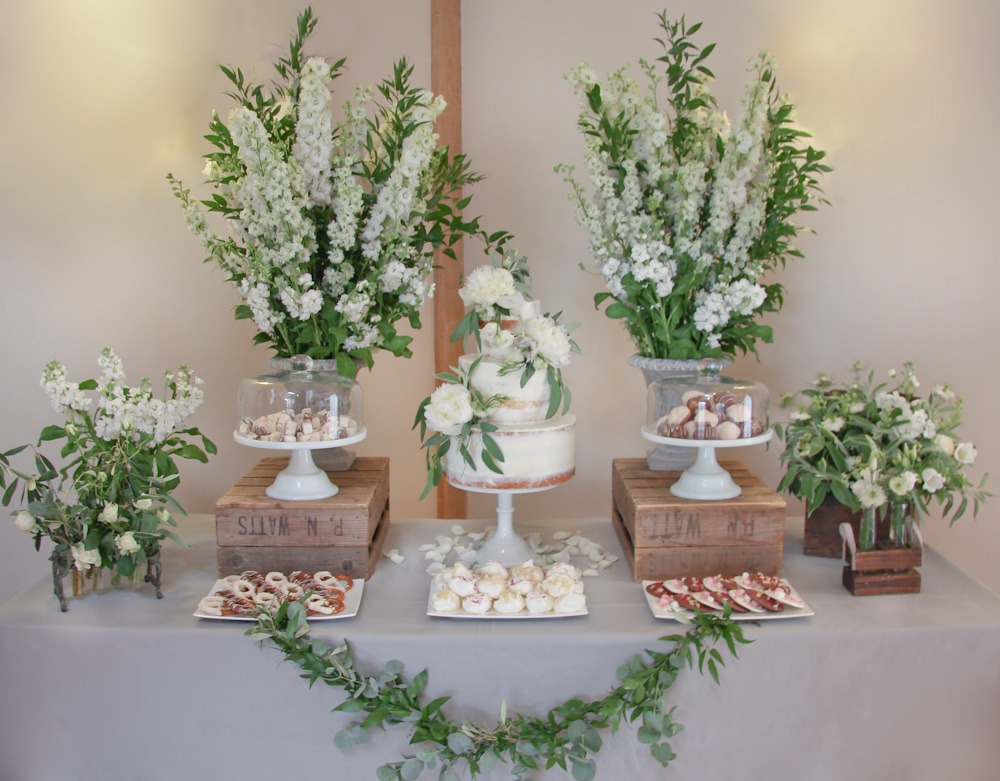 Rustic Foliage Semi-Naked Cake, Serves 125 portions, Price 335, plus treats £35 per plate, excl flowers