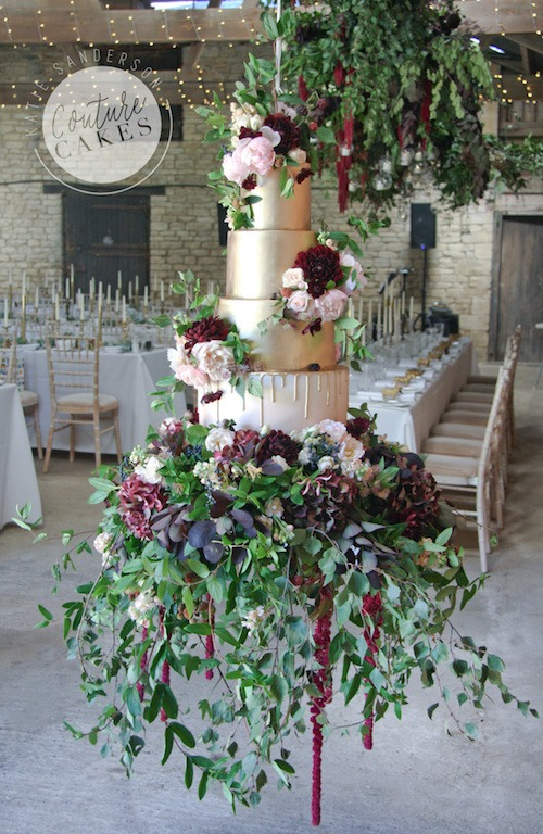 Suspended Gold Drip Cake, Serves 170, Price category C £835 plus £250 flowers