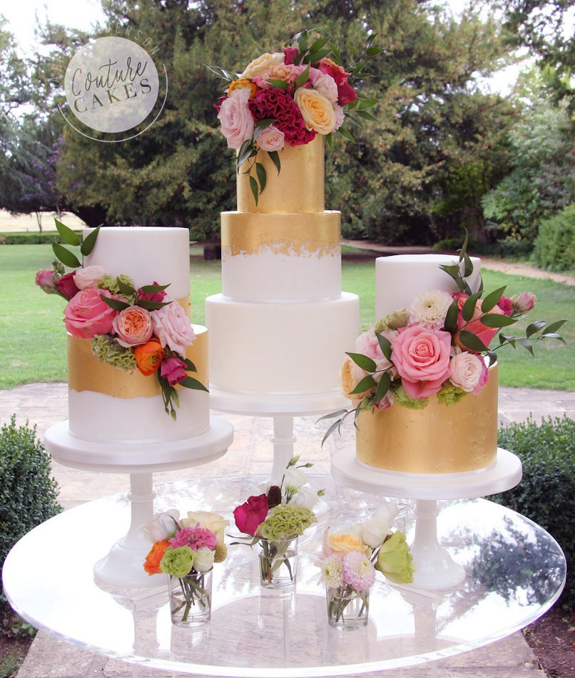Main cake serves 80 portions £425, 2x smaller cakes serve 55 portions each £275 each, total £975 excl flowers