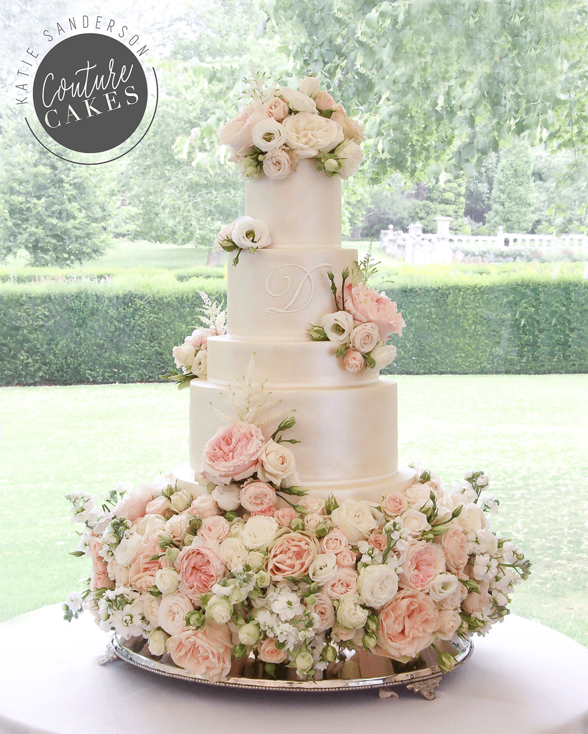 wedding cake with flowers on the side tiered wedding cakes couture cakes 26884